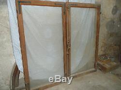 Ancienne fenêtre double en chêne à venir chercher