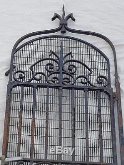 Ancienne porte d'ascenseur en fer forgé