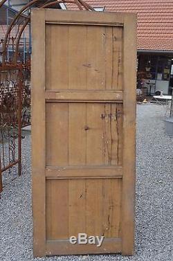 Ancienne porte d'entrée en chêne patiné