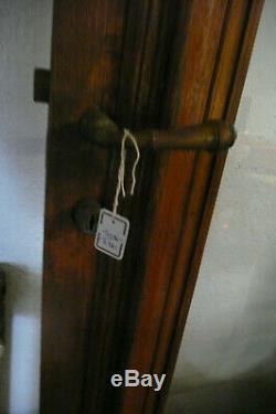 Ancienne porte de taxiphone vitrée chêne