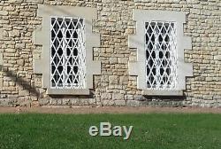 Deux grilles de défense fenêtres fer forgé, fabrication artisanat d'art