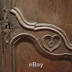 Deux portes d'armoires avec linteau fin 18ème chêne 1617-21