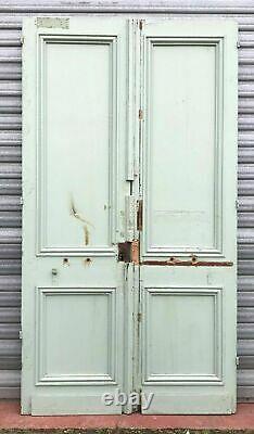 Double portes d'entrée a panneaux moulurés XX siècle