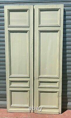 Double portes de passage a quatre panneaux moulurés XX siècle