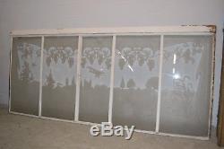 Façade avec des verres gravés / fenêtres