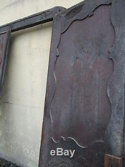 Façade placard ancien régence sculpté en chêne provenant d'un manoir