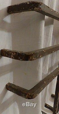 Grille de fenetre avec un caducée ancienne fer forgé beaux assemblages a mi fer