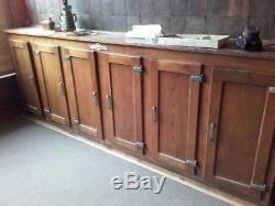 Meuble frigo de bar 6 portes 1940 en chêne, transformé en placard. Très bon état