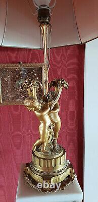 Paire de lampes en bronze doré, Deux Amours corne dabondance Epoque XIX° siècle