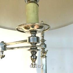 Pieds de lampadaire en laiton argente comportant bras amovible. XX siècle