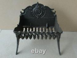Porte bûches berceau grille ancien de cheminée, en fonte, à réflecteur amovible
