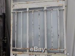 Porte d'atelier vitrée avec barres de protection année 30/haut 243 cm