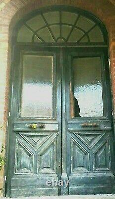 Porte d'entrée a deux battants et imposte en alcôve XX siècle