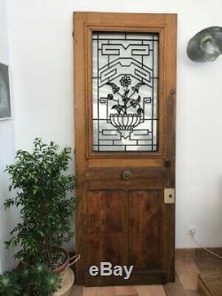 Porte d'entrée ancienne en bois massif et vitrée