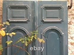 Porte d'entrée double ventail ancienne en bois massif