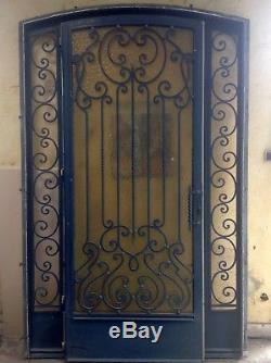 Porte d'entrée en fer forgé double vitrage fabrication artisanale