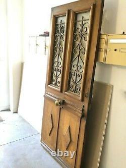 Porte d'entrée vitrée ancienne en chêne