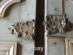 Portes de communication en chêne à deux vantaux double face avec encadrements
