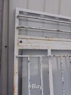 Rare porte d'atelier vitrée avec barres de protection année 30/haut 243 cm