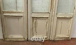 Suite de trois portes de séparation en sapin massif XIX siècle